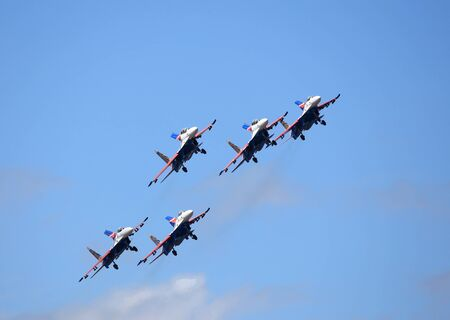 demonstrative: MOSCOW REGION - AUGUST 30: Demonstrative performance of the aerobatic team of Russian military aircrafts at the airshow on August 30, 2015 in Moscow region Editorial