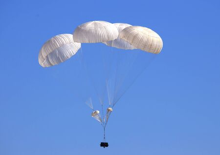 paradglider: Dropping cargo using military parachute system