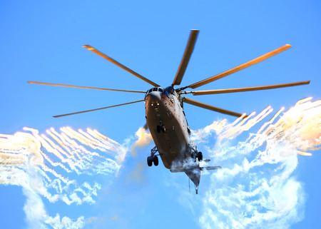 aircrew: Modern russian military  helicopter shooting back a false heat targets