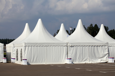 appointed: White tents at the exhibition camp appointed as pavilions Stock Photo