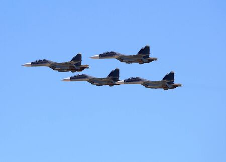 Group of russian fighters flying in a blue sky Stock Photo