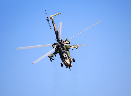 Modern russian attack helicopter  with rockets, bombs, guns