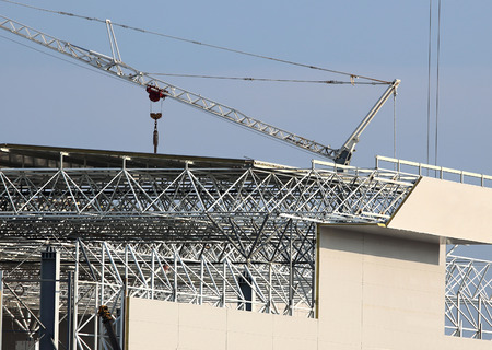 coverings: Construction site. Installation of coverings on a skeleton of industrial building during construction