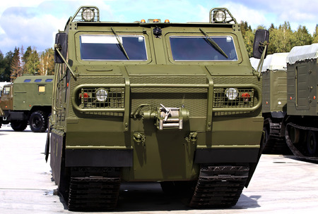 tracked: Military tracked transporter with a metal frame and box body vehicle with all-metal high-strength body