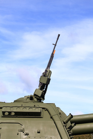 Rotating towerof the self-propelled gun consisting  service of  Russian army with   152 mm self-propelled howitzer,  and 12,7 millimeter anti-aircraft  machine gun