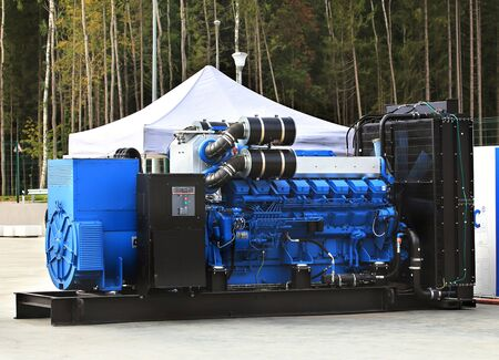 turbine engine: Gas turbine engine and a power generator mounted on a steel frame Stock Photo