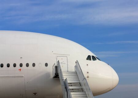 ploy: Large passenger jet  with attached ladder, side view Stock Photo