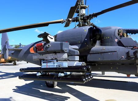 aircrew: Guided antitank missiles and starting block with unguided missiles on the modern combat helicopter pylons Stock Photo