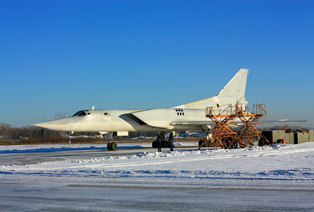 Russian bomber parked at a military airbase for service Stock Photo