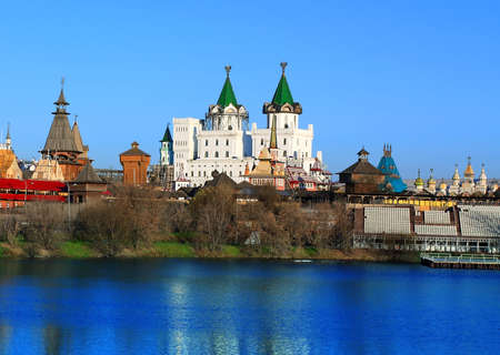 Ancient russian kremlin with colorful towers on the banks of the pond Stock Photo