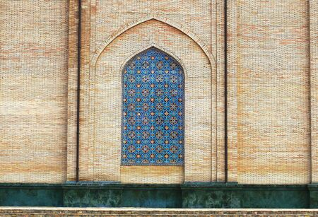 Decorative lancet arch with Persian painting in the Central Asian ancient building Stock Photo