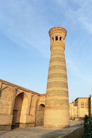 Mosque with minaret in the ancient historical city quarter in Central Asia