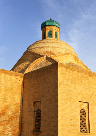 Old-time central asian  building with dome and small turret
