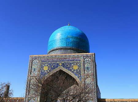 Medieval Central Asian mausoleum with oriental ornament and blue dome