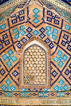 Black, blue and yellow patterns on the interior wall of the ancient oriental building