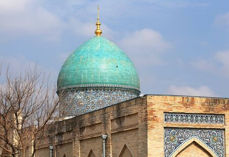 Old-time central asian styled building with blue dome and persian paintings