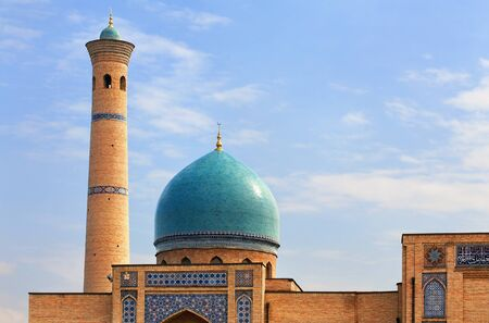 Old-time central asian  building with dome and minaret