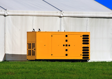 Yellow full container for a diesel power plant (diesel generator)