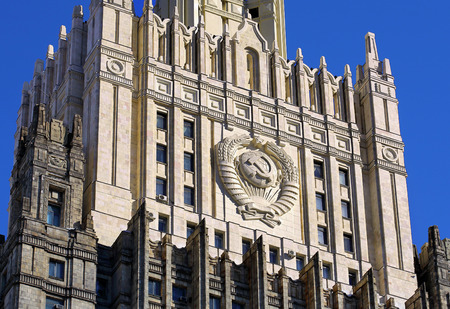 Monumental building with a spire and bas-relief of the USSR coat of arms