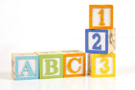 Childrens colorful blocks say abc and 123. photo