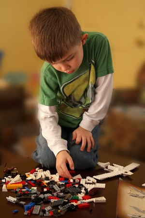 sucessful: Young Boy Building an airplane with blocks.