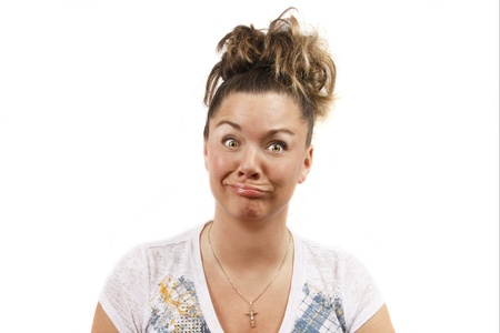 Middle aged young woman ahainst a white background making a crazy funny face.