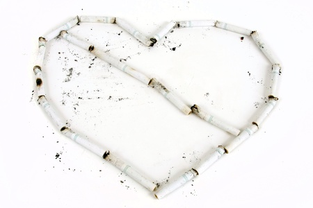 Cigaretts form a heart with a line through it.