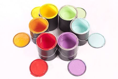 Colorful paint cans in a circle on a white background photo