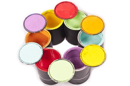Colorful paint cans in a circle with lids on top on a white background photo