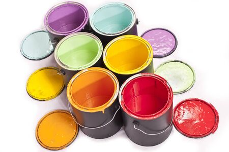 Colorful paint cans arranged diagonal on a white background photo