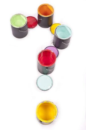 Colorful paint cans in the shape of a question mark on a white background photo