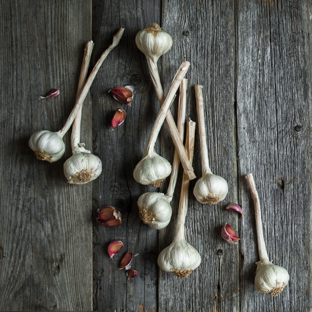 Bunch of garlic heads shot from above on wooden background