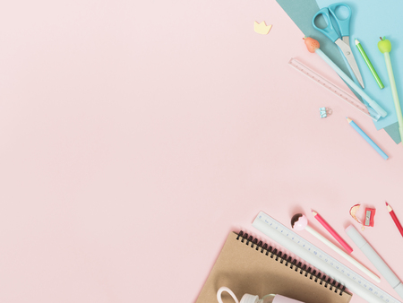 Colorful stationery on pastel pink background, school concept 免版税图像