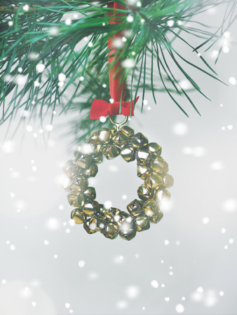Christmas card with a wreath of bells on a fir branch Stock Photo