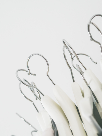 Close view of hangers white. Analysis of the closet. Seasonal buying and selling.