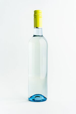 A bottle of white wine for the label layout on a light background. alcoholic beverage. branding