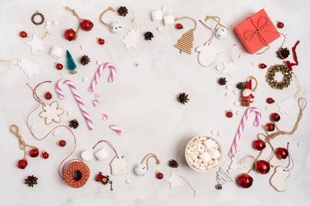 Christmas or New Year holiday layout with Christmas props, wrapped gift box, gingerbread cookies, festive vintage decoration toys, balls over on white background.