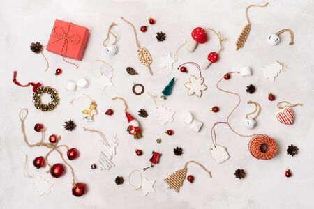 Christmas or New Year holiday layout with Christmas props, wrapped gift box, gingerbread cookies, festive vintage decoration toys, balls over on white background.  Standard-Bild