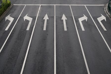 road marking: Arrow signs as road markings on a street with six lanes