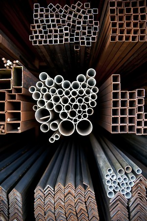 Different sizes of metal pipes on shelf photo