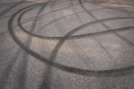 skid:  Close up of Skidmarks on asphalt