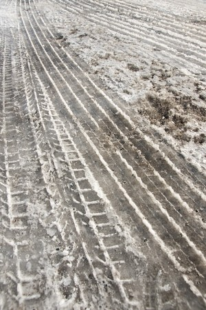Tire tracks in dirty snow Stock Photo - 8175190