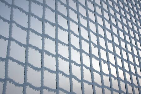 hoar frost: Metal net covered in hoar frost