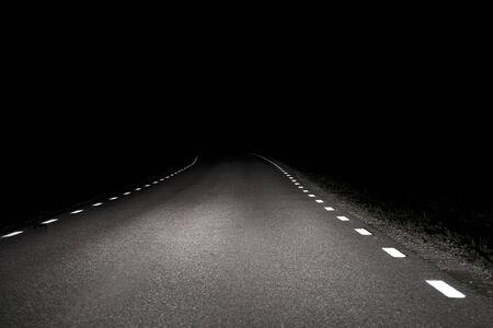 Rural asphalt road at night