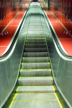 Escalators and red tiles with diminishing perspective Stock Photo - 8172239