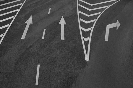 lane lines: Arrow signs and other markings on asphalt Stock Photo