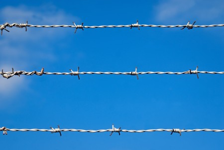 Barbed wire against blue sky Stock Photo - 8175303