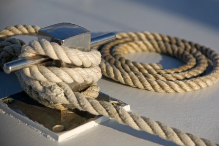 corded: Rope neatly rolled up on the deck of a  boat