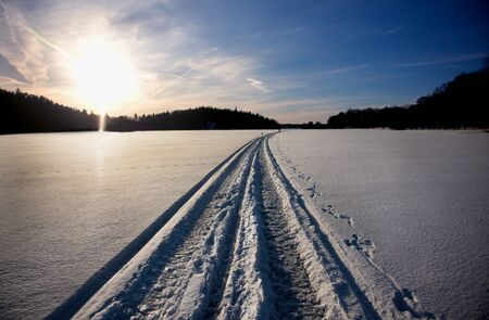 vanish: Tracks of snow mobile on lake in winter
