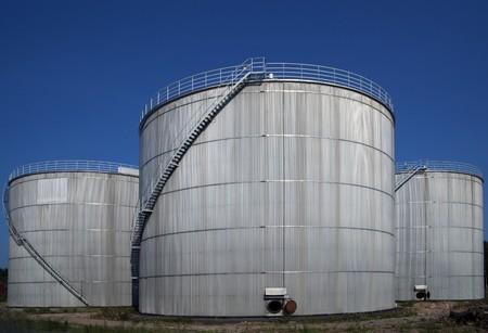 silos: Three silos with ladders Stock Photo